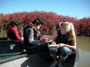 students writing in canoe